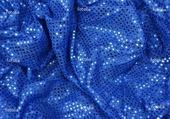 Jeux de puzzle : Tissu bleu avec pailletttes.
