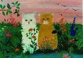 chats dans un pré