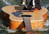 Puzzle Guitare sur l'eau