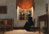 Woman knitting by a window