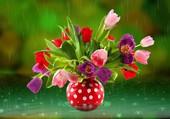 Tulipes dans vase à poids