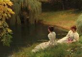 Dames élégantes au bord d'un étang