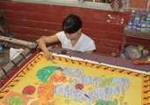 Artisane en tapis birmans