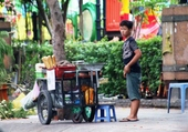Vendeur de rue à Ho Chi Minh.11