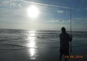 Pêcheur bord de mer