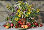 Composition fleurs et fruits