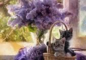 2 chatons dans un panier devant du lilas